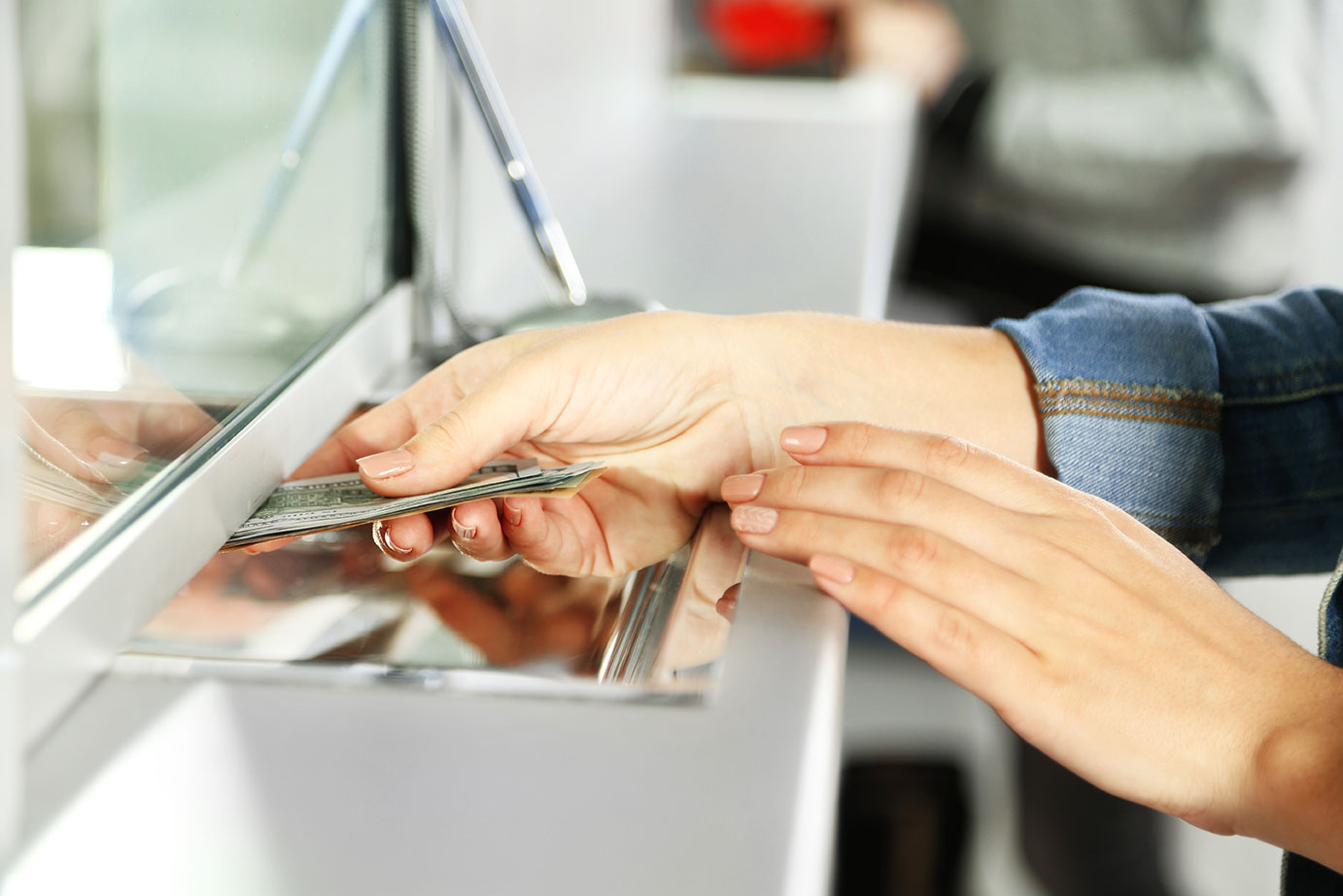 A Woman Depositing Cash at a Teller