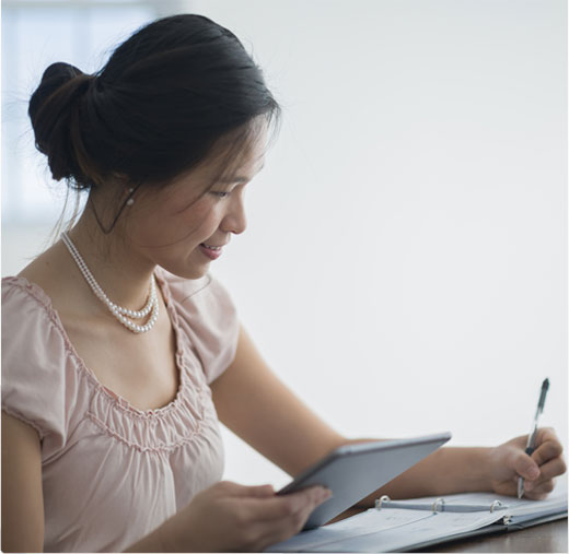 A Woman Tracking Her Business Transactions for Basic Business Checking
