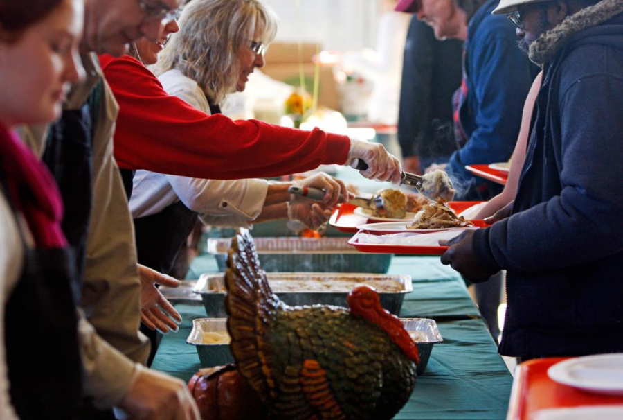 Volunteers serving food at food bank on Thanksgiving
